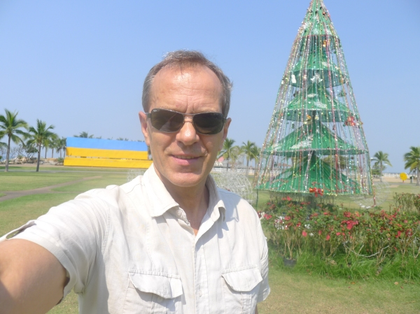 Me by a Chrismas tree near the beach in Thailand. 2016.